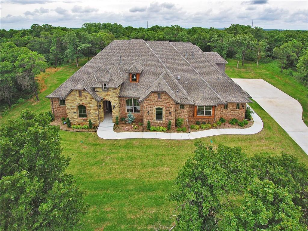 BUILDER MODEL CLOSEOUT!! BUILDER SAYS; MAKE AN OFFER!! Your chance to own a Quality Crafted Rich Kanaly home. Mr. Kanaly is truly a hands on builder, on the job site every day of construction, very rare in an age of production built homes. You won't find a better constructed home at any price point! Come see for yourself. OPPORTUNITY is KNOCKING! Gorgeous wooded 1.73 acre cul-de-sac lot in the new GRAND TIMBER ADDITION is the perfect setting for this 5 bedroom home. Unbelievable amenities: beautiful alder-wood woodwork w/over glazed satin stain on interior trim & custom cabinetry, 2-panel alder-wood passage doors, painted woodwork in Master Bedroom, Kitchen, Family Room, Formal Dining & Entry, large granite kitchen island w/ breakfast bar, oak wood hand-scraped wood floors in entry, gallery, formal dining, study, kitchen & living room, transitional style lighting fixtures & hardware, large utility room with built ins & mud room at garage entry, covered OUTSIDE living area w/ fireplace.