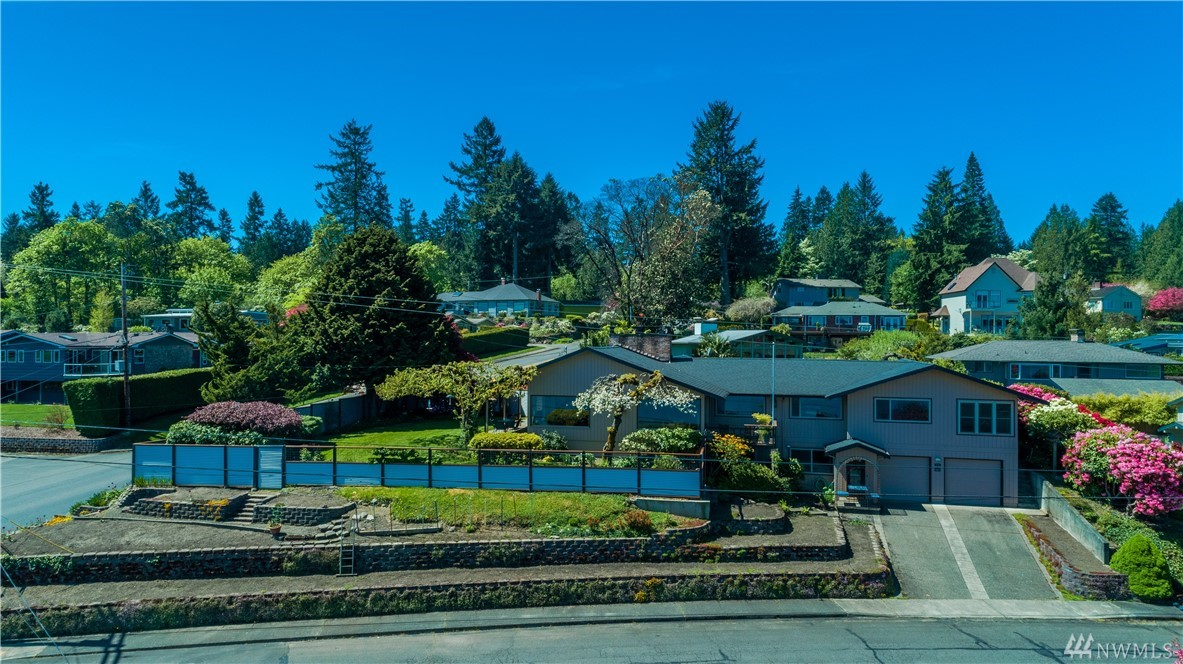 Absolutely one of the best views in Olympia. Mount Rainier, Budd Inlet, City and even Mt. St. Helens! Appointed rambler partially remodeled with daylight basement. Lower level rec room with separate kitchenette makes great guest quarters. Large Ironwood deck for entertaining. 4 covered parking spaces. Beautifully landscaped. Must see.