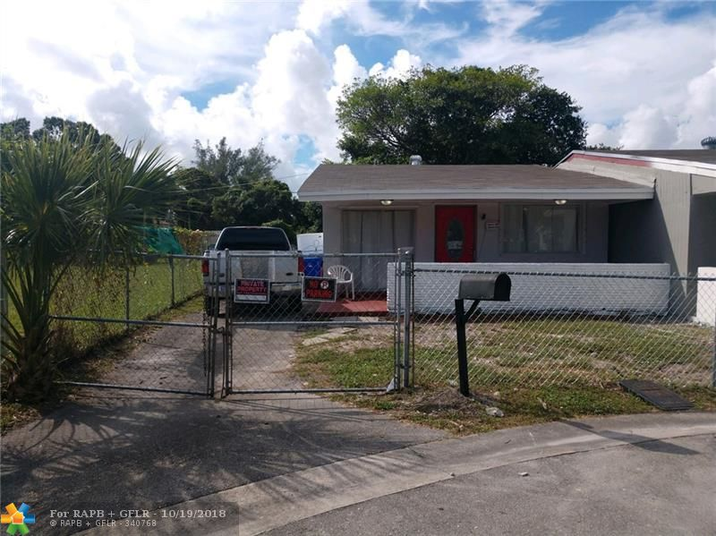 BEAUTIFUL & FULLY UPDATED 2 bed / 1 bath SFR. New roof, New kitchen cabinets, counters and s/s appliance package.  All new tile bathroom including cabinets and fixtures.  Freshly painted interior and exterior.  Full-sized washer/dryer hook-ups. Central AC. Fenced yard and front entry porch.  Located between I-95 and the Florida Turnpike proximate to Roosevelt Park