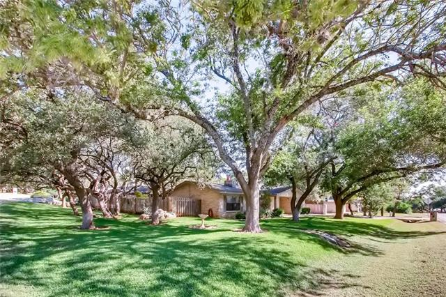 The Oak Trees are to Die For! This lovely spacious home is situated on a quiet & gorgeous homesite offering a canopy of beautiful oak trees. The home is immaculate, has a fantastic floor plan & a wonderful private backyard. Excellent for entertaining! Additional features: big breakfast bar, office, huge game room, doggie doors, new roof, superb landscaping, dog run, new fence, separate AWESOME workshop, fully insulated usable attic, & oversized 2 car garage. Lake Travis privileges-boat ramp!