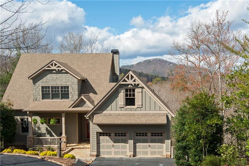 Exceptional home in Georgia's premiere gated mtn community! Luxurious, tasteful styling - immaculate! Entirely upgraded 2017. New large kit with top-of-the-line appliances. Mstr and laundry on main. 2 BR upstairs with J&J BA. 2 BR/2BA on terrace level rec room with coffee bar, sink and refrigerator for guests. Entertain on large porch. Multiple large decks. Mtn and golf views. 3-Zone HVAC. Newly painted interior/exterior. New landscaping. Move-in ready! Convenient to amenities.
