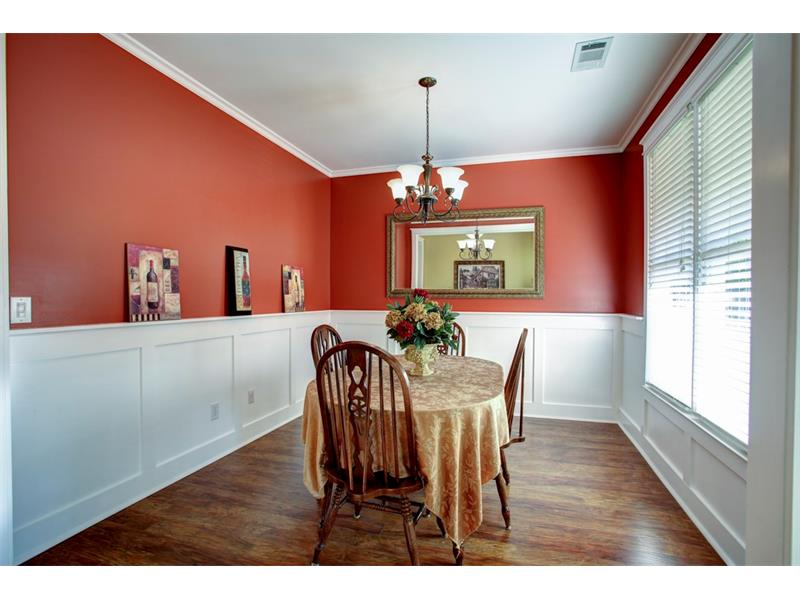 This dining room could easily accommodate a 6 or 8 person dining table.