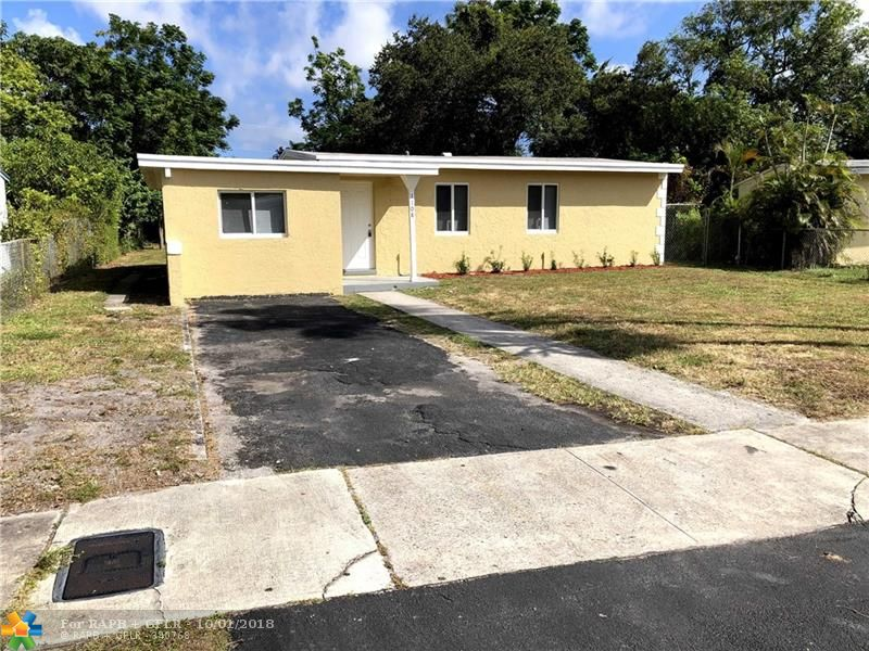Beautiful renovated 4 bedroom 2 bathroom house. Features high impact PGT windows and doors all around. Kitchen with white all wood cabinets and granite counters and brand new bathrooms. HUGE backyard with tons of room for a pool, entertaining and other projects. Schedule a showing today!