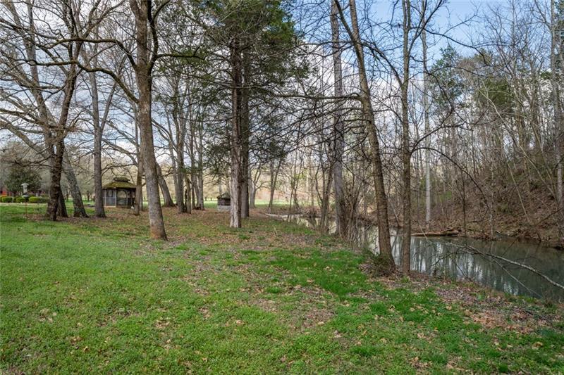 Gazebo by the Creek Area that runs thru the property.