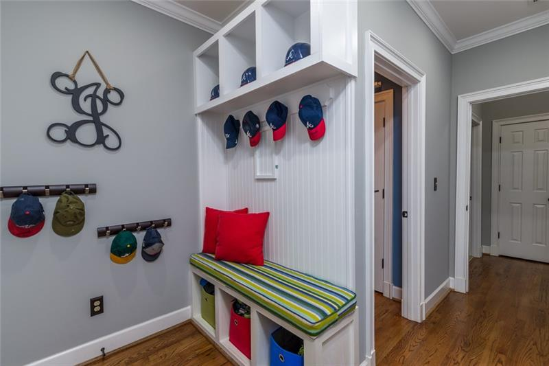 Adorable hall tree located in laundry room for shoes, backpacks & coats!