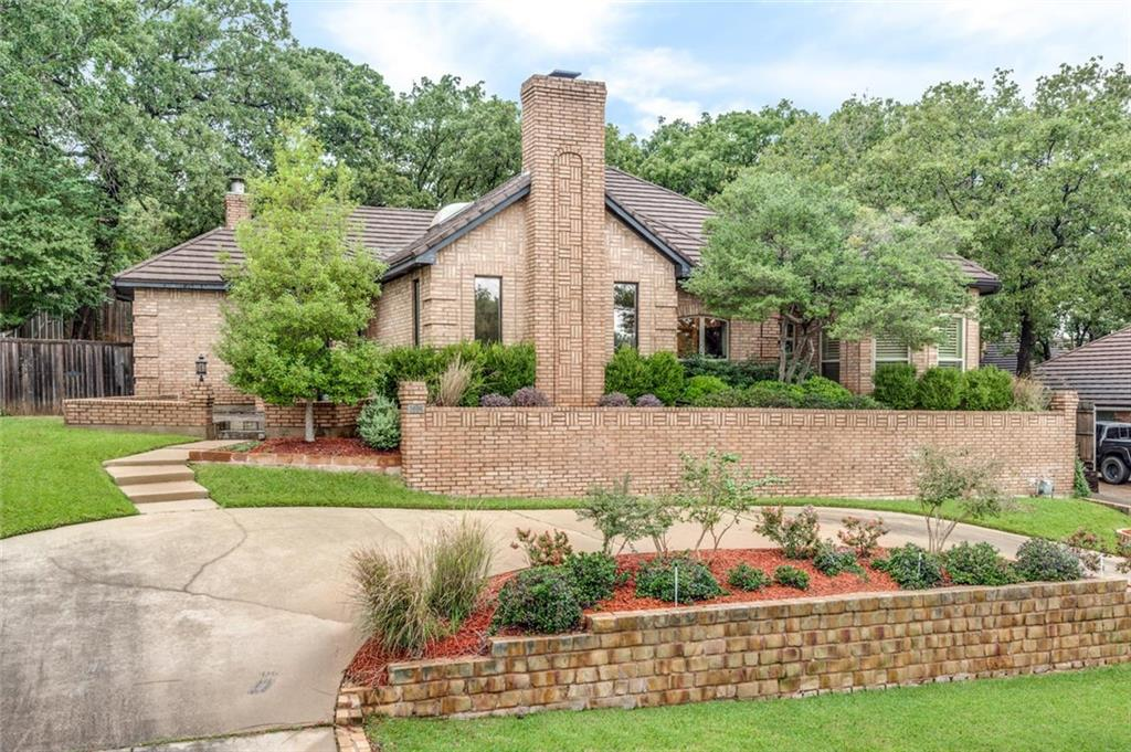 Beautiful Custom ONE STORY Home in Heart of Colleyville! Updated with Hardwood Floors, Modern Fixtures & More! Great Open Living & Dining Area with Floor to Ceiling Brick Wood-Burning FP with Gas Starter. Second Living could be Game Room or Man Cave & has Gorgeous Stacked Stone FP! Kitchen boasts of Upgraded Cabinetry, Granite, Double Oven & Stainless Steel Appliances. Priv. Owners Retreat has room for Sitting Area & Large Spa Like En-Suite with Dual Vanities, Jetted Tub, Separate Shower & Dual Walk-In Closets. Split Floor Plan has 3 additional Bedrooms & 2 Full Baths. Huge Wet Bar Area & Unique Atrium is great for Entertaining! Minutes from DFW Airport, Dining, Shopping & Entertainment. Easy Access to Hwy 121!