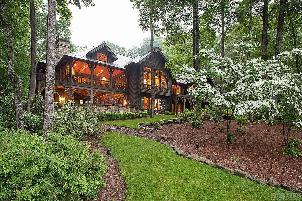 Located in one of Lake Toxaway's most private and pristine settings near the headwaters of Lake Cardinal, this Al Platt designed masterpiece has it all. Impressive in and outdoor living surrounded by natural landscape with over 300 feet of frontage on the crystal clear waters of Lake Cardinal. The home features four large bedrooms/baths, two half baths, six fireplaces (indoor and out), a slate roof, cedar shingle and native stone siding, IPE decking and antique timber frame beams. Stone and antique hardwood flooring complement the oak, cypress paneling and plaster walls. The home has a Lutron Audio and Video System with security features and, If needed, a hydraulic elevator is installed from the main to lower level. While extremely private, the home is a short drive to the Lake Toxaway Country Club and marina with all the accompanying amenities.