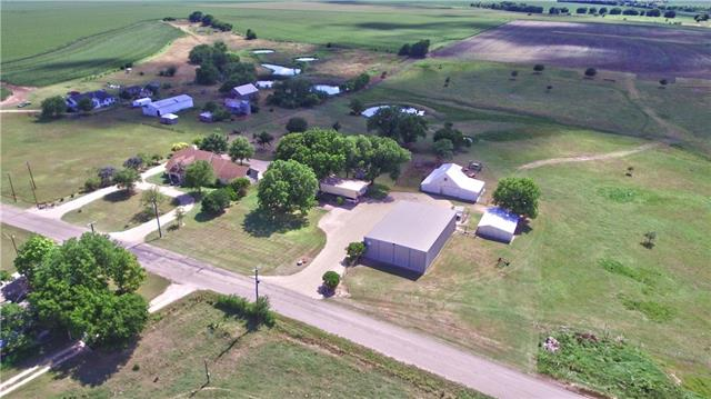 Between Hutto and Taylor, 10 min. from 130 Toll and 20 mi. from I-35. 3/3 two-story Austin Stone home on 88+/- acres of gently sloping, black farmland. Property has beautiful panoramic views of neighboring farmland and spectacular views of two enormous ponds used by UT for competitive ski training. Storage building(s), covered RV/boat parking, 50'x75' equipment shed, two-story, antique barn w/original interior-in amazing shape and a huge entertaining pavilion w/fireplace overlooking everything!