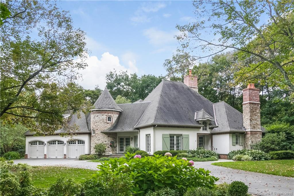 Enchanting chateau nestled on a private lane in West Norwalk Neighborhood.  This cul de sac is near the Darien and New Canaan Borders.  Easy access to either train or highway.  Less than 1 hour to NYC.  Built by Country Clubs Homes - This property boasts a first floor master suite with doors open to the stone patio.  Upon entering the home you will feel the European influence in the design.  Vaulted ceilings, beams and beautiful hardwood floors are featured thru out the house.  The rooms lend themselves to both formal and informal dining spaces.  The Chef's kitchen has custom cabinets, granite, stainless and a walk-in butlers pantry. Truly a cooks dream as the chef over looks the fireplace and great room.  A breakfast nook can be found with doors to the stone patio.