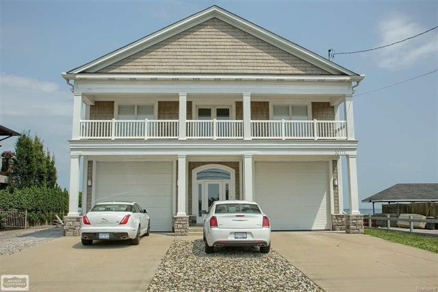 Awesome completely renovated cape cod with 6-car heated garage overlooking Lake St. Clair; home features all of today's up-to-date color schemes & decorating trends, fantastic views, very unique location with break wall at lake giving a harbor type-cove setting w/4 boat wells & 2 hoists (20,000 lb. hoist & 4,000 lb. hoist), nice open floor plan, huge upstairs great room loft overlooking lower great room, front & rear 2nd floor balconies offering great views, heated 6-car attached garage w/12' overhead doors, car lift & high gloss premium epoxy floors, chef's gourmet kitchen open to great room, wide plank hand rubbed hardwood floors throughout, extra parking on side of house for winter boat storage,.  No sign on property.