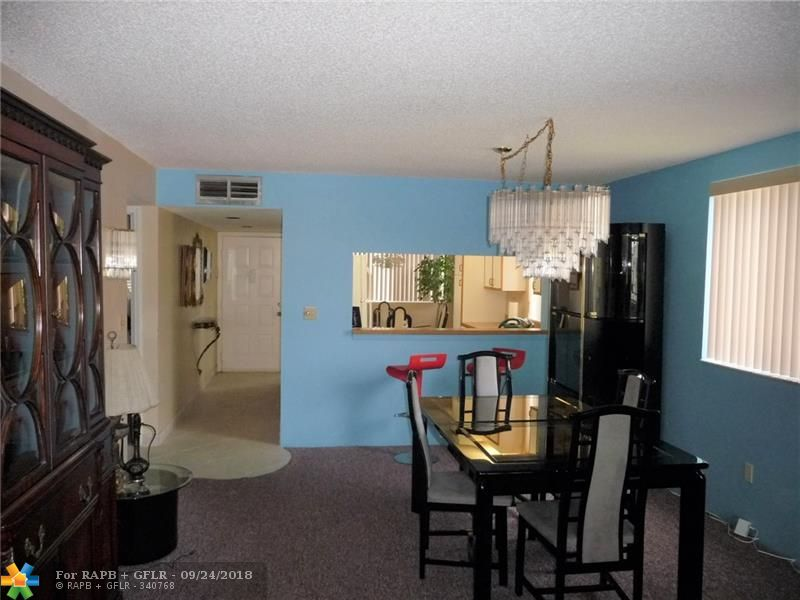 Top floor corner unit in good condition at a good price. Water views, eat in kitchen. Laundry room with full size washer and dryer. Gated entrance with 24 hr security. Community pool and clubhouse. 55 + community.