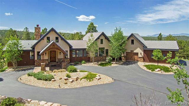 Extremely private Colorado mountain estate with outstanding custom design. Entry opens to grand great room with rear wall of windows and framed views of Pikes Peak. No expense has been spared on the woodwork, doors, beams, floors and hand troweled walls. Home sits with true North/South coordinates for ideal sun/shade exposure year round. The gourmet kitchen has a large counter with an eat on bar, Wolfe appliances and double ovens. Master suite with spa bath opens to deck with hot tub. Secondary guest bedroom with ensuite bath on the main level. A warm and charming office/library with gorgeous window and setting. Family room downstairs has a wood burning fireplace and walks out to the covered patio. A wine cellar and 2 additional bedrooms downstairs. Its hard to describe all the features in the limited space. Excellent design into this impressive home! Mature forest of Ponderosa, Douglas Fir and Blue Spruce. No covenants, 38 acres, pond, mountain views and yet 15 minutes to Divide.