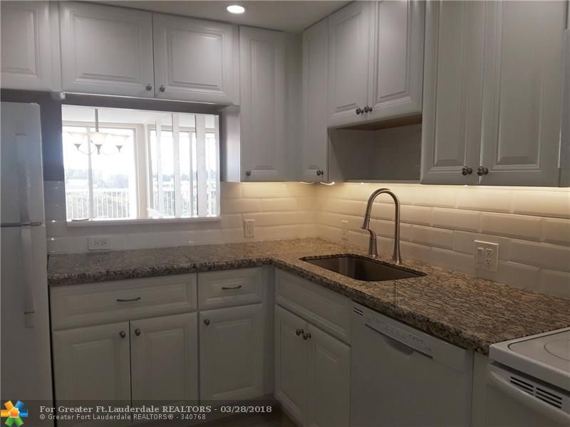Immaculate! Remodeled in 2016 with Permits: Kitchen, Porcelain Tile, Hot Water Heater, Electric Panel. Recently painted. Updates in Bathrooms. Master BD Carpet New in 2015, A/C New In 2014.  Windows are Impact. Assigned Parking Space, 2nd from Front Door! Cats Allowed, 20% Down Req & Interview by Assoc, No Lease 1st Yr., Overnight Security Patrol, Condo offers Heated Pool, (3) Golf Courses in Palm Aire Community. All ages!! Must see!!