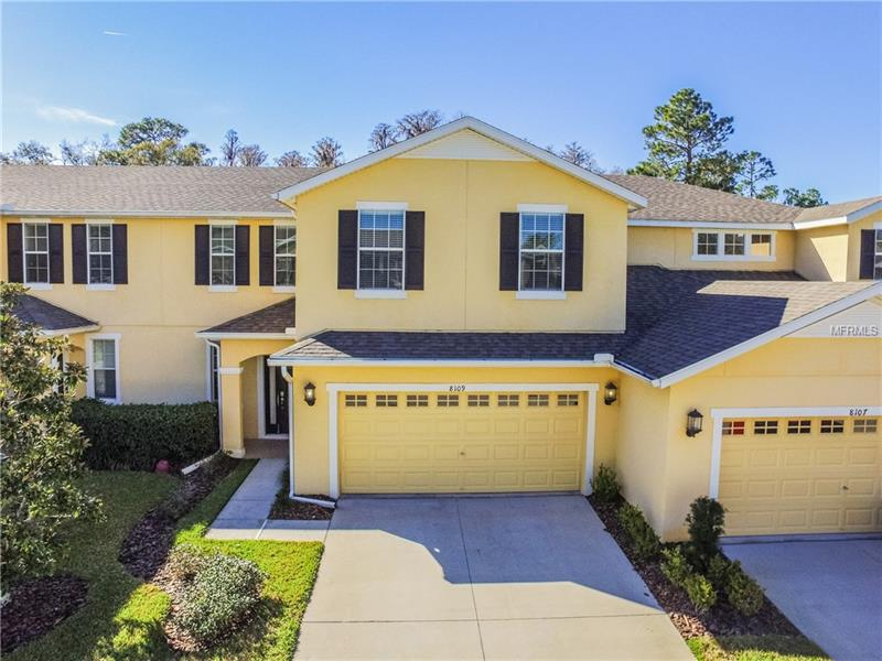 Beautiful well maintained Town Home located in the highly desired community of Grand Hampton. Built in 2013, this all brick construction home, showcases 3 bedrooms, 2.5 bathroom, 2 car garage + a loft. The spacious kitchen boasts GRANITE COUNTERS, STAINLESS STEEL APPLIANCES, WOOD CABINETRY and a breakfast bar. On the second floor you can find a large loft which can be used for an office or bonus room. Spacious master bedroom with a luxurious master bathroom, GRANITE DOUBLE SINKS, GARDEN TUB AND A WALK IN TILE SHOWER. The two additional bedrooms, a full bathroom and a laundry room complete the second floor. The community residents enjoy amenities such as resort style heated pool, lap pool, hot tub, tennis courts, fitness center and playgrounds. The Grand Hampton is just minutes away from shops and entertainment and with easy access to I-75 and I-275.
