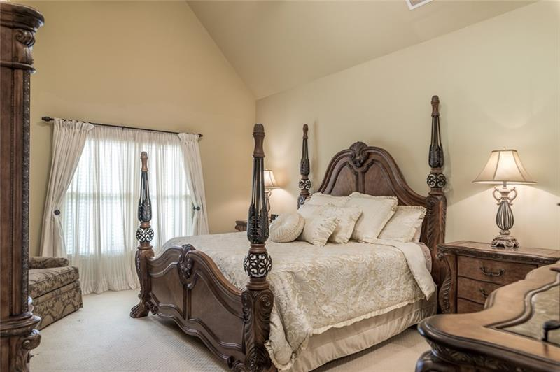 2nd floor bedroom with cathedral ceilings