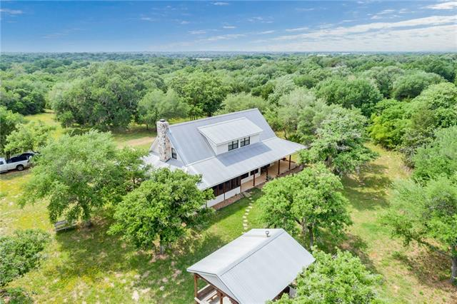 Wonderful retreat in a country gated country community of Oak Ridge Ranch!  Lovely 2,314' hm w/9' wide wrap around porch.  Mst down w/glass door  to patio porch Up-2 bdrms w/dormers that sleep 1. Kitchen-open concept. Dining open den w/fpl/Wrap around windows w/views of (2) ponds/nature. Screened in porch! Some furnishings to stay. Outside 16x20 covered BBQ area / 24x40 Barn w/4 roll up doors/2 septic systems/this property has 3 tax ID.- 72+ac.  Two ice ponds, and great hunting! Stands and Feeders set up!