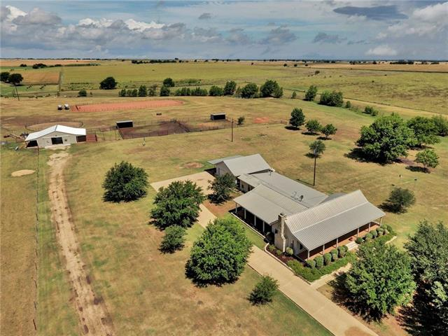 """Immaculate 53.34 acre horse ranch with 3169 sf custom home in Holland, Texas. The home offers a 3bd, 3ba, with gameroom, office/den, mud rm, three covered porches, large living rm with fireplace and two car detached garage with """"lean to"""" covered storage.  Topo is mostly level w/ black soil, 2-20 acre coastal fields, wet weather crk and spring-fed pond. Barn has 4 stalls w/ tack rm and wash area. 60' round pen, 2 - 80'x80' paddocks w/ loafing sheds and 120'x200' riding arena. Ag exempt and no restrictions."""