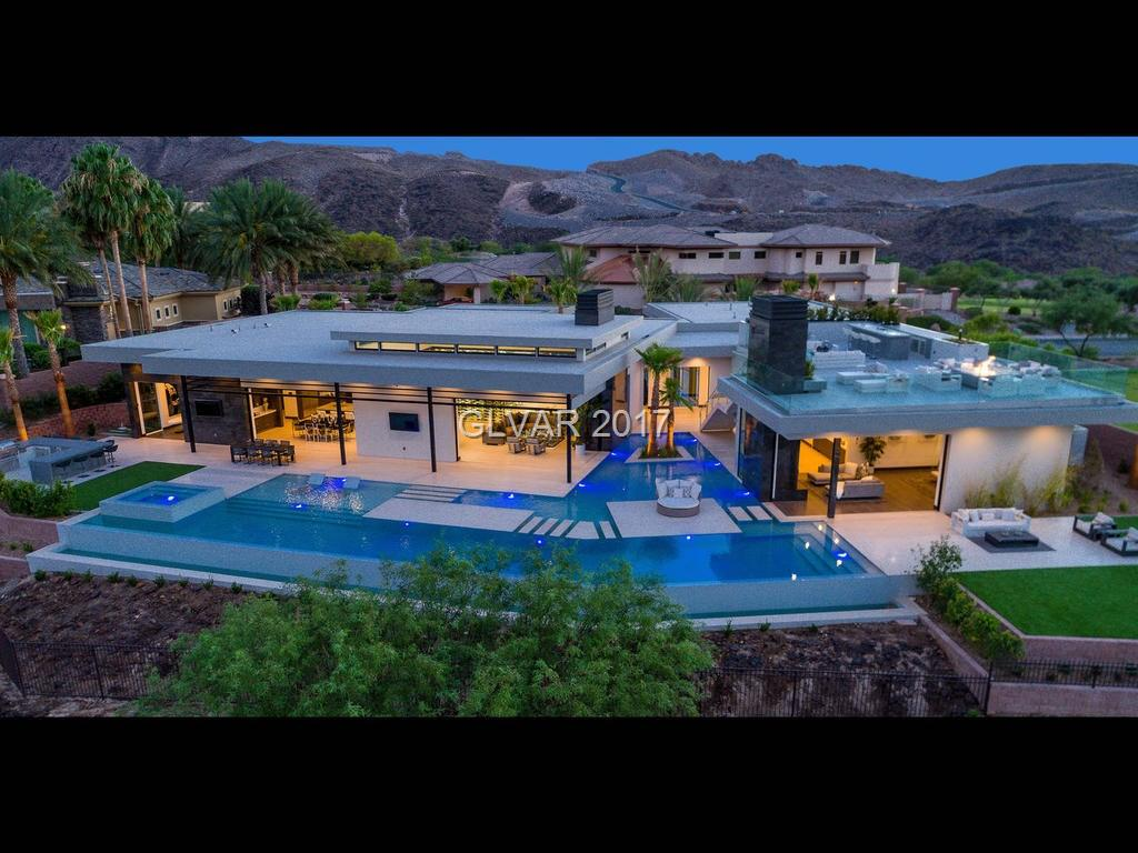 Serenity is offered Turnkey... The Essence of Luxury – An extraordinary home, overlooking all of Las Vegas & Dragon Ridge Golf Course, boast 8,494 square feet of luxury living, razor-sharp attention to detail and jaw-dropping design, Wine Cellar, Wet-bar Gourmet kitchen, Fabulous Master Retreat, Spa Inspired Master Bath, Guest Suites, Office, Movie Theater, Wellness, Fitness Center, Resort Style Pool & Spa, Built-in Barbecue and Lifestyle Deck.