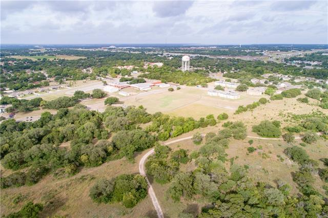 Incredible views of the city, hill country and more! Perfect building site bordering Nolan Creek. Just minutes from the downtown center of beautiful Belton. Cabin with pool ready for your remodeling! Owner financing possible, perfect gentleman's ranch with a King of the Hill view!