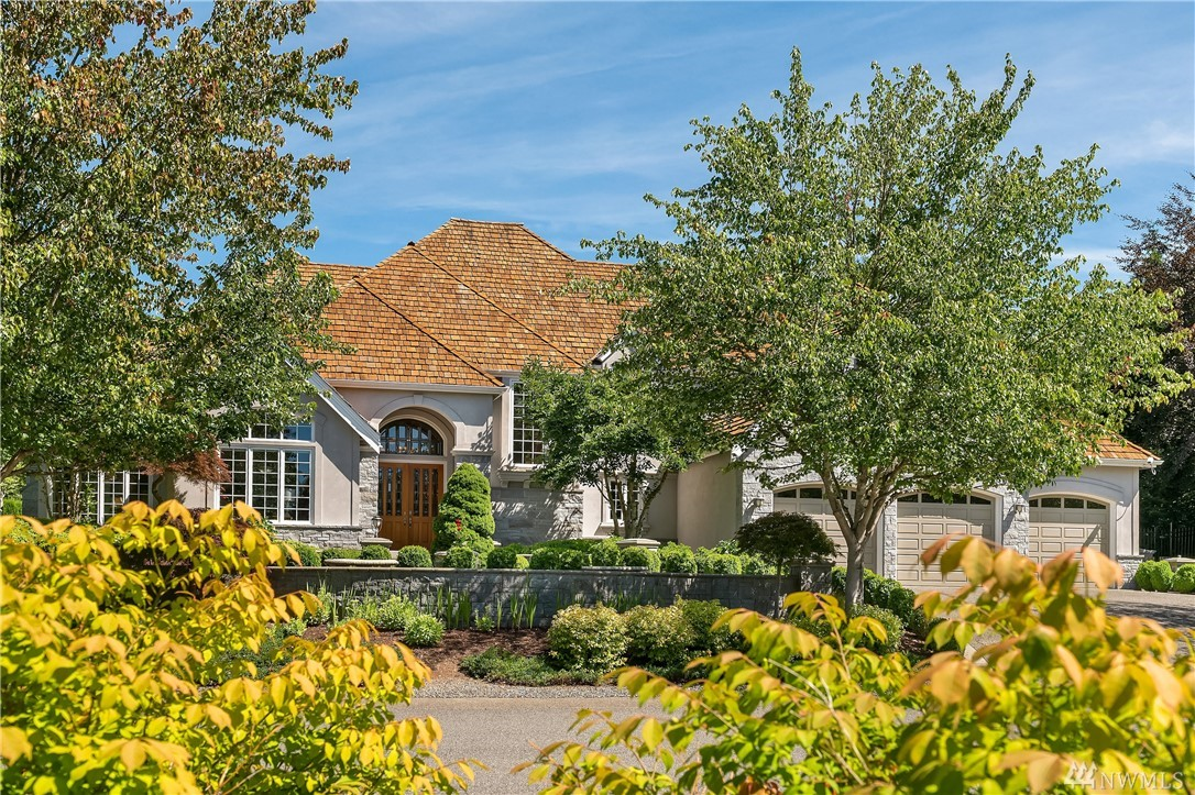 This former John Buchan model home greets w/ Grand Entry featuring soaring ceilings, wrought iron staircase & leaded glass accents. The stainless & slab Culinary Kitchen w/ expansive center island built for entertaining. For the wine enthusiast, enjoy a temperature-controlled Wine Cellar. Windows walls of natural light & a scenic backdrop of courtyard gardens & landscaped estate grounds. With private wooded sanctuary & community Nature w/ Equestrian Trail, this is truly a one-of-a-kind property!