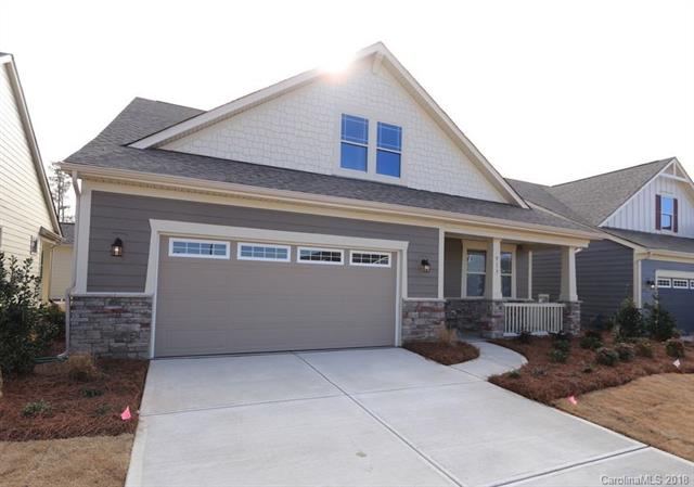 Beautiful New Community in Tega Cay offering low maintenance ranch homes with close proximity to Nivens Creek Landing, Baxter Village and Rivergate Shopping Center. A welcoming covered front porch invites you in to this stunning home featuring an open floorplan and tons of windows looking out onto your side courtyard patio, bringing the outside in! You'll love the kitchen with it's wrap around island and ample storage. Relax in the sitting room off the owner's suite - a true owner's retreat! This home is a 1 1/2 story home and features 3 bedrooms and 3 bathrooms. Second floor features a large bonus, bedroom and bathroom!