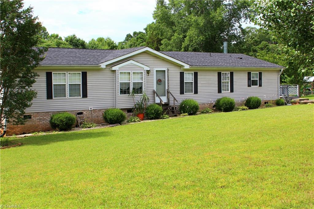 Nicely maintained home on almost an acre, convenient to King and Winston-Salem but still rural.  Has open floor plan with fireplace in living room.  Covered back porch and large back yard.  Home just had roof replaced in 2015. Roomy with over 1700 sq ft 3 bedroom and 2 bath. Great home for the money!