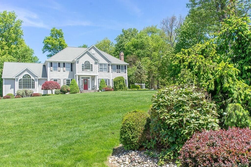 Curb-appeal colonial located on a cul-de-sac in the most coveted section of Trumbull. Down the walk way and through the front door stone surrounds is the two story entryway foyer. To the right, enter the living room and first fireplace or walk through to the timeless country kitchen. Detailed cabinet work, granite countertops, extra seating and a gas stove with range hood and painted tile. Built-in ovens in the floor-to-ceiling cabinets, as well as a large pantry and extra counter space. From the kitchen, enter the dining room, family room or open the sliders to the back deck. Cathedral ceiling in the family room along with large arched windows bringing in plenty of natural sunlight. Hardwood floors and high ceilings throughout the home. An office and full bath complete this floor. Up the stairs through double doors is the grand master bedroom with a walk-in California closet and full bathroom with double sinks and tub. Visit the additional three bedrooms down the hall or the seating area by the window overlooking the yard. Down the stairs to the lower level is the basement with another full bath, exercise room, lounging area and kitchenette. The outside of the home offers a backyard space for any recreation along with a stone patio and deck.