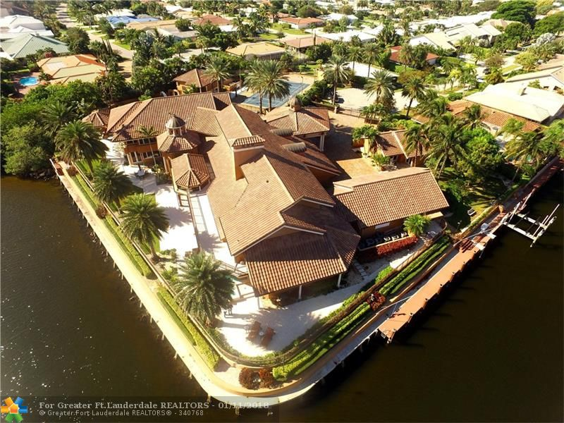 Absolutely the most magnificent estate in LHP, this compound is direct ICW/1.63 acres encompassing 6 full lots w/ 425' of waterfront. This incomparable home features 7BR/7.5BA,office,elevator,fitness center, massive formal & leisure areas, club room w/sit down bar & pool table room,sprawling resort pool,pavilion w/ summer kitchen, sweeping motor court,6-car garage,soaring Porte Cochere. Approx 15,000 sf, this estate includes main home,guesthouse,pool home, tennis & volleyball courts,private Jacuzzi.
