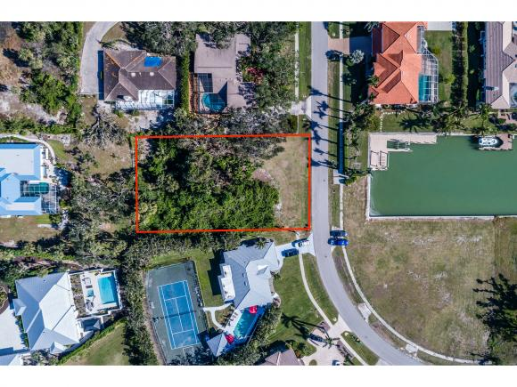 Build your dream home in the Estates area on this incredible, oversized lot! Water views down the canal from this lot directly across the street. Owner owns adjacent home and would sell together for over an acre of land in the tranquil estates area.
