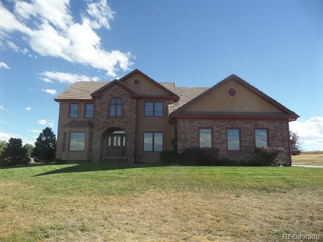 Wonderful remodeled family home on 2 acres with city and mountain views and cul-de-sac location.  The home has been recently remodeled with new stainless appliances, carpeting, paint and refinished hardwood flooring.  All three second floor bathrooms have been beautifully remodeled with tile flooring, granite counter tops and new vanities.  The master bathroom has heated flooring and large soaking tub.  The kitchen has slab granite counter tops, large island with cook top stove and desk. The family room has vaulted ceilings and a wet bar.  The basement has a large rec room with wood wainscot, two bedrooms with egress windows and a full bathroom.  The storage room is large with access to the crawl space.  The furnace and air conditioning unit are new.  The stamped concrete patio has a hot tub and fire pit.  The exterior is stucco with a concrete roof for low maintenance.
