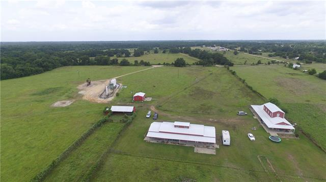 35 +/- Acres in Paige, TX ..IF you are looking for unusual then THIS IS IT!!! Unique BARNDOMINIUM Custom with cedar ceilings, Concrete floors, Cedar beams, Cedar is everywhere and smells of cedar. Was used and built as an organic farm and has the potential to be brought back to life. There are several outbuildings.. and about 60 Pecan trees and a grape arbor. Scenic Pond..  mineral rights convey.