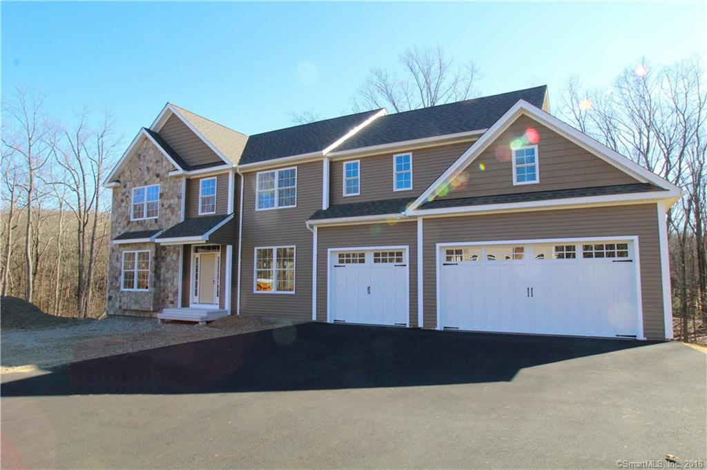 """Located in desirable Huntington Wood.  This brand new Colonial is up & framed. This home has an open floor plan & a 3 car attached garage. Built wil energy efficiency in mind this home is set up as a """"Smart"""" home.  Call for details."""