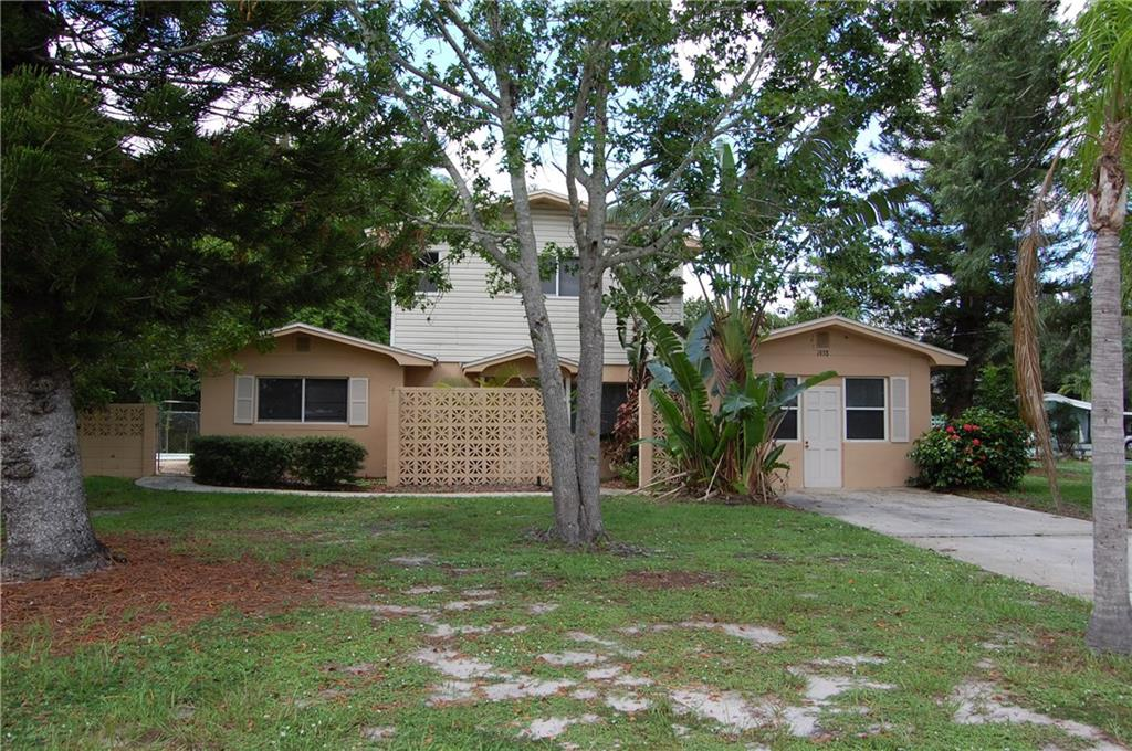 Check out this 2 story 4 bedroom, 2.5 bath pool home in Fort Pierce on an oversized corner lot! Kitchen cabinets are newer with stainless steel appliances. First floor has tile throughout main living areas and there is carpet in the bedrooms. The upstairs has wood floors throughout. Great location, as you are minutes from the college campus, Lawnwood Medical Hospital and downtown Fort Pierce. Don't miss out!