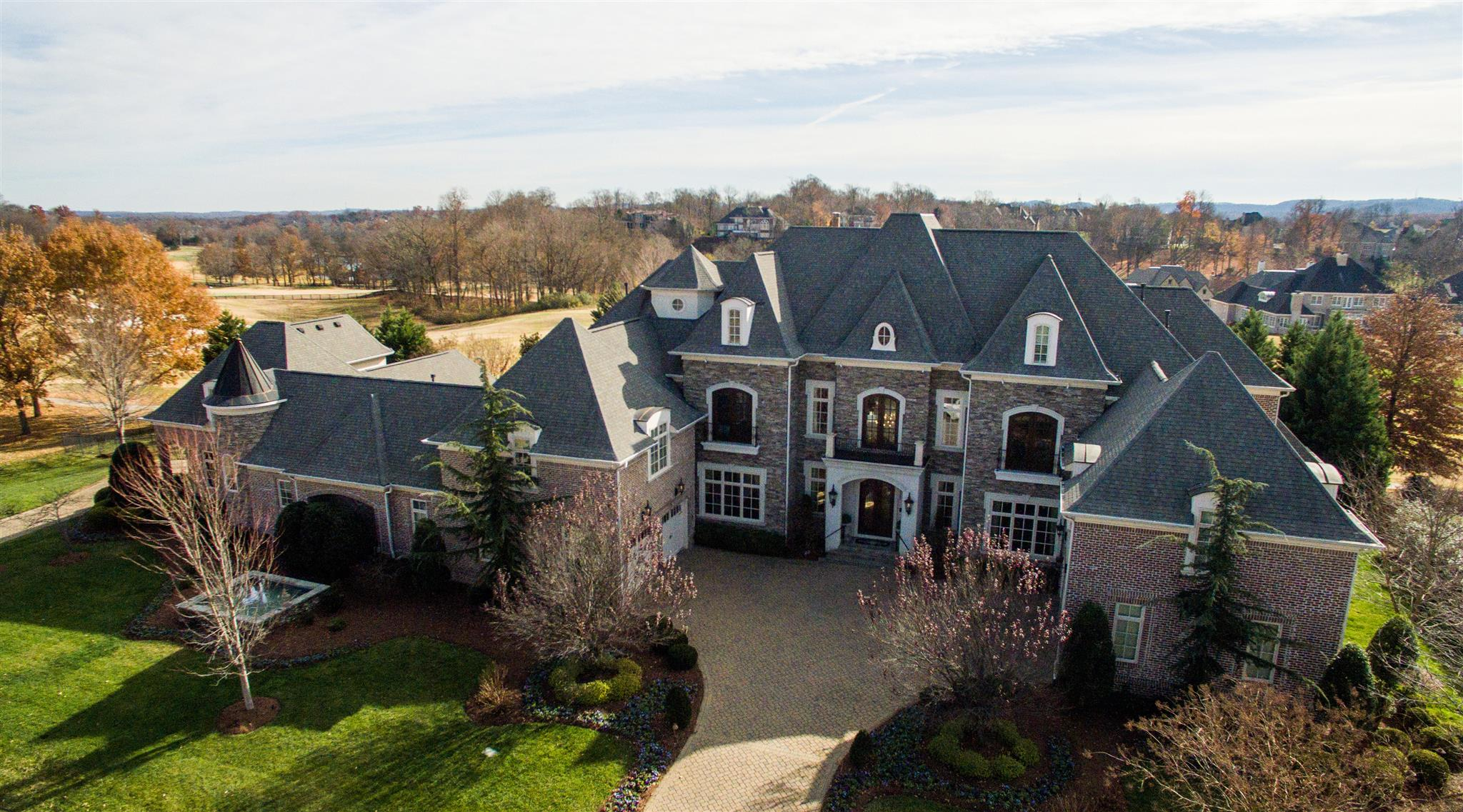 Stunning estate on 18th Fairway. Open floorplan. Beautiful hardwood floors. Chef's kit. Outdoor living w/gunite pool, hot tub and kitchen. Theatre. Billiard rm. Exercise rm. In-law quarters. Elevator. Safe room. Large yard.