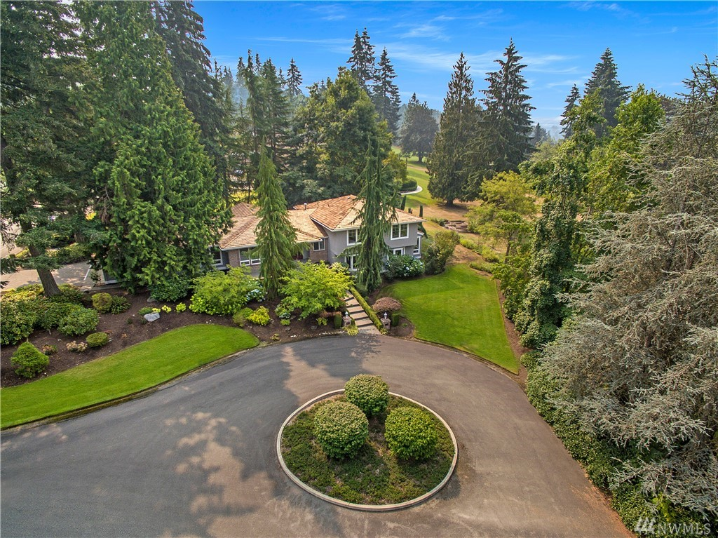 24/7 gated community. Resort style living. Expansive custom tri-level on 17,730sf lot. 4BR, 3.5BA, den, rec rm, library/hobby, greatrm and formal living & dining. Incredible greatrm w/chef's kitchen, nook w/gas FPL, family rm, all opens to multi level covered & uncovered deck & yard beyond. Master w/5 piece bath & private deck. Huge rec rm. Views of 16th fairway but no ball encroachment. Large yard for outdoor activity. Fabulous landscape! Across from excellent community park. Wilder Elem.