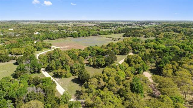 Rare find with 10 private acres, over 3600 sqft  4/5 bedroom home,3 full baths. Detached garage with bonus room above. Barn for horses or cattle. Chicken coop, outbuilding, patio areas, fire pit, garden, huge Oaks. This property will Wow you! At the end of the street, this is a private gated estate. Tile and concrete flooring in main areas, beautiful beamed ceilings. Updated kitchen with island and stainless appliances. Nice barn and fenced area for livestock w/perimeter fence. Retreat from the city!