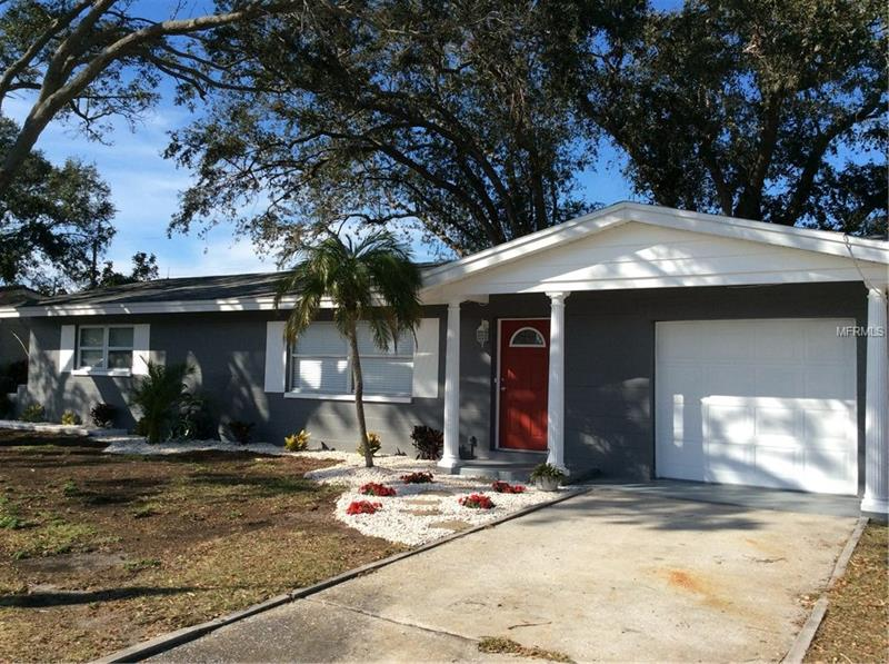 ***DREAMS CAN COME TRUE - LIVE JUST 2-1/2 MILES FROM THE GORGEOUS GULF BEACHES***  Come see this beautifully remodeled OPEN FLOOR PLAN 1,212 sq ft 2-bedroom, 1-bath block home with 1-car garage. Home is centrally located in the highly sought-after Seminole Ridge neighborhood, just blocks from the new vibrant Seminole City Center – Shopping and Entertainment District and ½ mile from Seminole City Park. A block down the street and you're on the Pinellas Trail.  Beautiful 180 sq ft Florida BONUS ROOM (included in total sq ft) with new A/C. Fenced back yard.  NEW KITCHEN, including new cabinets and GRANITE countertops with breakfast bar. Appliances include: Refrigerator, Stove, Microwave and Dishwasher. Bathroom has also been remodeled. Beautiful Terrazzo flooring throughout with new laminate flooring in the Florida room.   House has been freshly painted both inside and out.  New master electrical panel installed with all new lighting fixtures throughout the home. Washer/dryer hookups with new laundry sink in garage. Many new Hurricane rated vinyl windows installed, with new blinds throughout.   BRAND NEW upgraded 30-year architectural shingle ROOF just installed this month (February 2018).  New roof has Scotchguard, anti-mildew shingles with upgraded water-proof underlayment - check with your insurance agent for applicable mitigation discounts.  Roof has a transferable warranty.  Don't miss out on the wonderful Florida Gulf Beaches Lifestyle… Owner/Agent
