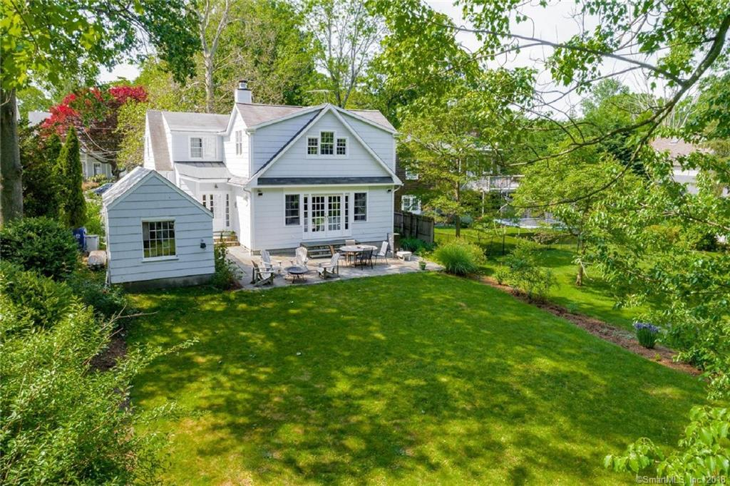 Inviting and sunny interior spaces with abundant natural light. Popular, centrally located cul-de-sac neighborhood in the middle of Rowayton, with easy access to village, school, train, library, parks and harbor.  Dog friendly level back yard with Terrace.   Owner holds CT Real Estate Broker license