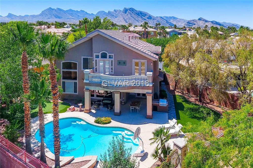 LOCATION! - 10,000 sq ft, cul-de-sac lot that backs to the greenbelt, walking trail & park!  Lovely Summerlin home with pool, putting green, large trees & water smart landscaping.  Stunning light throughout the home.  Features include three bedrooms plus a downstairs den & a spacious upstairs bonus room.  Island kitchen opens to the family room, ceiling fans, three fireplaces, granite counters, tile floors, stainless appliances.