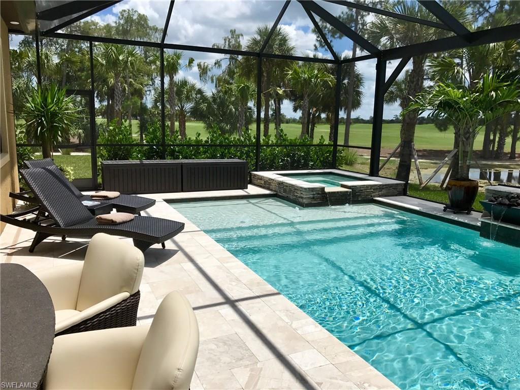 This gorgeous custom home is Robb & Stucky's 2017 Sand Dollar Single Family Award winner for Interior Designer of the Year. This exceptionally built residence is located on an end lot with magnificent Golf & Lake views. The house features a great room floor plan with large sliding glass doors, creating a breathtaking connection to the outdoor lanai. The lanai offers a pool/spa, waterfall features, built in fire pits, and a custom outdoor kitchen with plenty of casual dining space for your ultimate outdoor enjoyment. This residence has been professionally designed and furnished with luxury and style in mind. Designer and architectural details include custom detail tray ceilings with crown molding detail with beautiful wall finishes. An integrated media, TV, and sound & security system is installed throughout the home. Complimenting the property is an oversized garage providing maximum parking & storage space.  Golf Club of the Everglades is a private 18-hole golf course that includes an almost- completed world-class club and recreation area Resort pools with an indoor/outdoor restaurant.