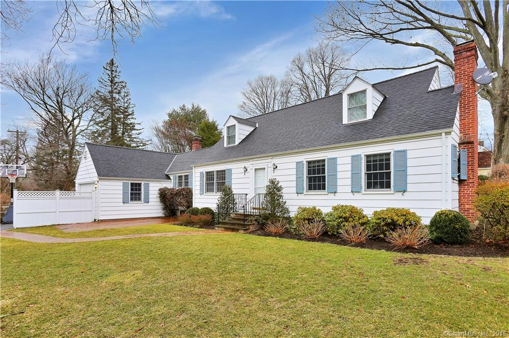 Charming four bedroom Cape is set in a prime location on a well-landscaped level .26 acre within walking distance to trains, Riverside Elementary, Eastern Middle school and the village of Old Greenwich.  A center hall entry way reveals hardwood floors and graceful curved archways. The main level is comprised of a spacious living room, anchored by a wood-burning fireplace; a dining room enhanced by tasteful chair-rail; an efficient crisp white kitchen with pantry; wonderful family room with vaulted ceiling, loft, bath with shower and access to attached garage, and two well-scaled bedrooms with a Jack and Jill bath.  Master bedroom, single bedroom and a full hall bath complete the second level.  Enjoy the ease and convenience of living in this established Riverside neighborhood.