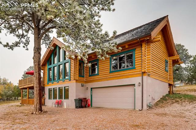 "Stunning custom Colorado log home. 9"" Swedish cope log home with Pikes Peak view, located at the end of a cul-de-sac and only 6 minutes from the heart of Woodland Park. From the moment you walk into the great room you will not want to leave. Oversized main level master suite with a sitting area, attached 5 piece bathroom and large walk in closet."