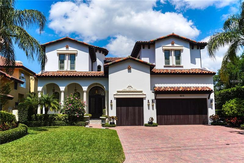 Absolutely stunning custom built waterfront home with breathtaking open bay views. You will be swept off your feet as though you have entered a private oasis retreat. Spectacular open custom designed commercial kitchen  leads into into great room with exquisite granite counters throughout. Enormous wine cellar holding 890 bottles with a custom designed granite wall. High ceilings throughout featuring stained beams, tongue and groove ceilings in living room with built in cast stone fireplace open to dining room. Enormous master suite with its own large balcony also complete with its own wet bar and two sided fireplace in bathroom suite with a large his and her shower. Guest room on ground floor with full bath. Three additional bedrooms and fitness room all designed with hardwood floors. There is a covered lanai overlooking infinity pool with a covered outdoor cooking area and a pool bath.  Must see to appreciate all fine details of this luxurious home!