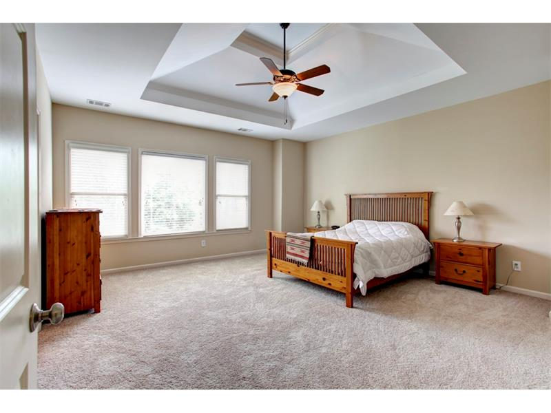 Spacious master bedroom with sky high treyed ceilings
