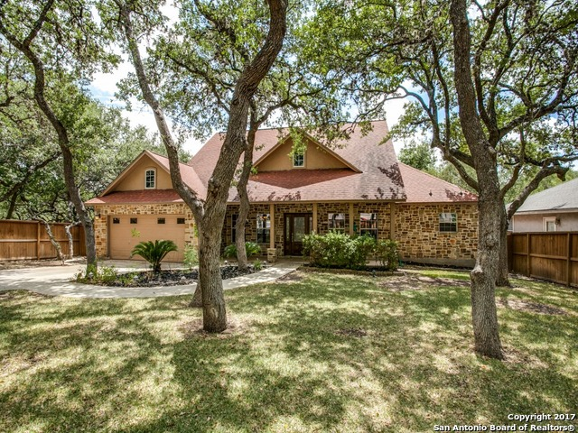 OPEN HOUSE: Sat (10/21) & Sun (10/22), 12-3 pm! Custom one-owner home with four sides rock. Spacious deck/cvrd front & back porches. Beautiful yard/landscaping. Liv rm features fireplace, sparkling Brazilian cherry flooring, architectural columns & coffered ceiling. Family room w/corner wet bar. Well-designed ktchn w/granite/brkfst bar, Master suite w/coffered ceilings, two closets, pedestal sinks, jetted garden tub, shower & linen. Secondary bdrms boast Jack-n-Jill bath all in one room. Excellent location!