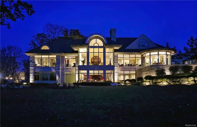 This Lou DesRosiers masterpiece on coveted Upper Straits Lake is one of Oakland County's most stunning estates. Over 11,800 sq ft of exquisitely finished living space, including the finished walkout lower level. This meticulously crafted home sits on one of the most premier lots on the lake w/ sunset views, beautiful formal & informal spaces for entertaining, an indoor lap pool, home automation, elevator & incredible attention to detail throughout. Enter the grand foyer leading into the sun drenched great room that features floor to ceiling windows, a double sided fireplace & beautiful hardwood floors. The gourmet kitchen offers a oversized island & breakfast nook overlooking the lake. A formal dining room, luxurious entry level master suite, well sized au-pair/in-law suite & a sophisticated wood paneled study are just a few of the magnificent features of this grand estate. Truly a flawless residence, designed for entertaining & relaxation on private, all-sports Upper Straits Lake.