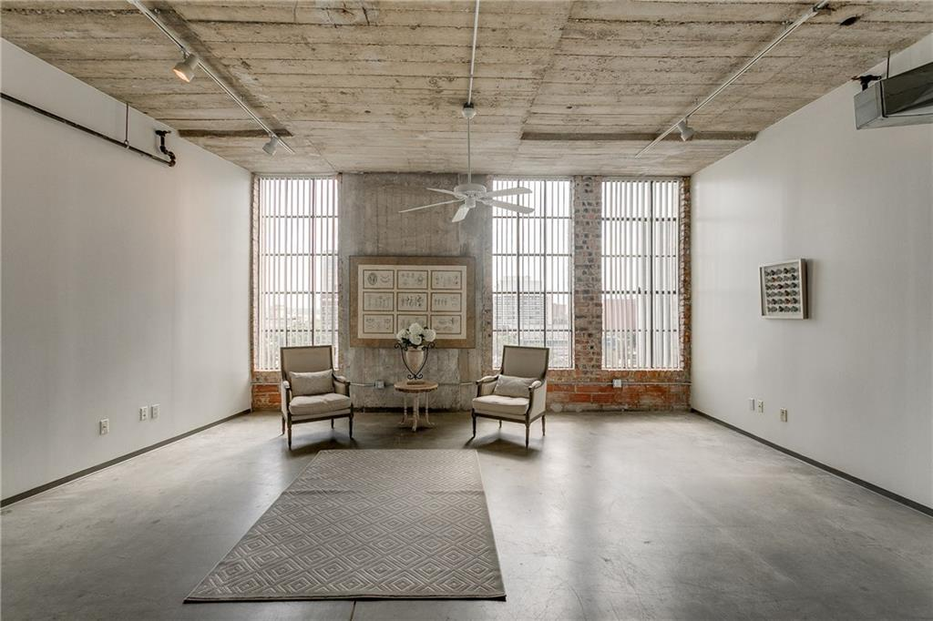 Own Your Own Extremely cool Industrial flat In The Heart Of Downtown! Open living floor plan. Walls of windows offer tons of natural light and great views over Margot Hunt Bridge. Freshly painted unit and easy to keep stained concrete floors. Lobby Manned 24 Hrs. Roof Top Pool With Grilling. Fitness Center. Separate storage. Less than a mile from AA Center, Perot, Clyde Warren Park, Aquarium, House of Blues, Arts District. Has Washer & Dryer Connection but also offer Laundry Rooms on certain floors. Fridge remain with unit. High speed Internet is offered in HOA fees. Easy to show.