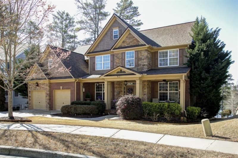 Enjoy stunning lake views from this beautiful Harmony on the Lakes cul-de-sac home! Kitchen features stainless steel appliances, granite counters, pantry, breakfast area, and opens to cozy keeping room. Great room boasts a soaring ceiling and fireplace with floor to ceiling stacked stone! Formal living and dining rooms perfect for entertaining! Master suite is a true retreat including a trey ceiling, walk-in closet, and luxurious master bath with a double vanity, jetted tub, and separate shower. Additional bedrooms are well-sized and bright! Fully finished terrace level offers three bedrooms, full bath, and additional living space with kitchenette. Wonderful outdoor living including a large deck and screened porch. Amazing community amenities include multiple pools, tennis courts, playground, clubhouse, and much more!