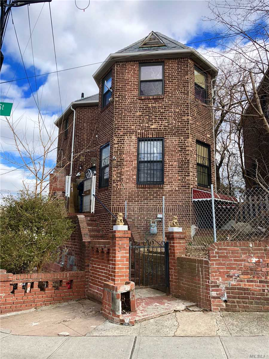 Prime Corner Development Location Facing Queens Botanical Garden! Has Two Blocks & Lots. On Second Empty Lot Can Build Brand New Two Family House Semi-Attached To Existing Property. This Is A Developer's R4-1 Zoning Dream Property! Couple Years Young Boiler & Heating System. All Information Must Be Verified By Buyer.