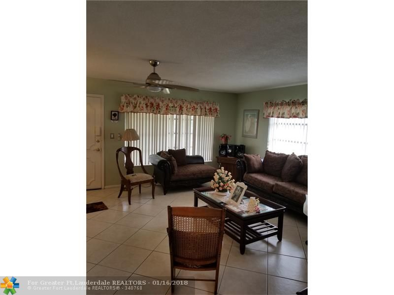 BEAUTIFUL 2/2 CORNER UNIT THAT'S LOCATED IN LAUDERDALE OAKS 55+ COMMUNITY. TILE IN THE LIVING ROOM AND TILE THROUGH OUT.  IT IS VERY CLOSE TO THE ELEVATOR AND LAUNDRY FACILITIES. THIS UNIT IS VERY CLEAN AND WELL KEPT. PROPERTY BEING SOLD AS-IS WITH RIGHT TO INSPECT.
